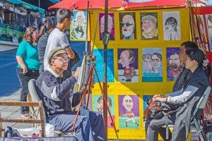 Straatartiest tekent portret, Canada
